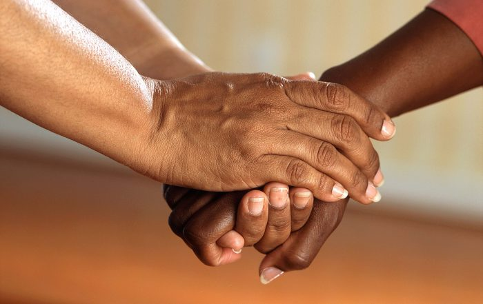 Hands held in caring manner - mental health